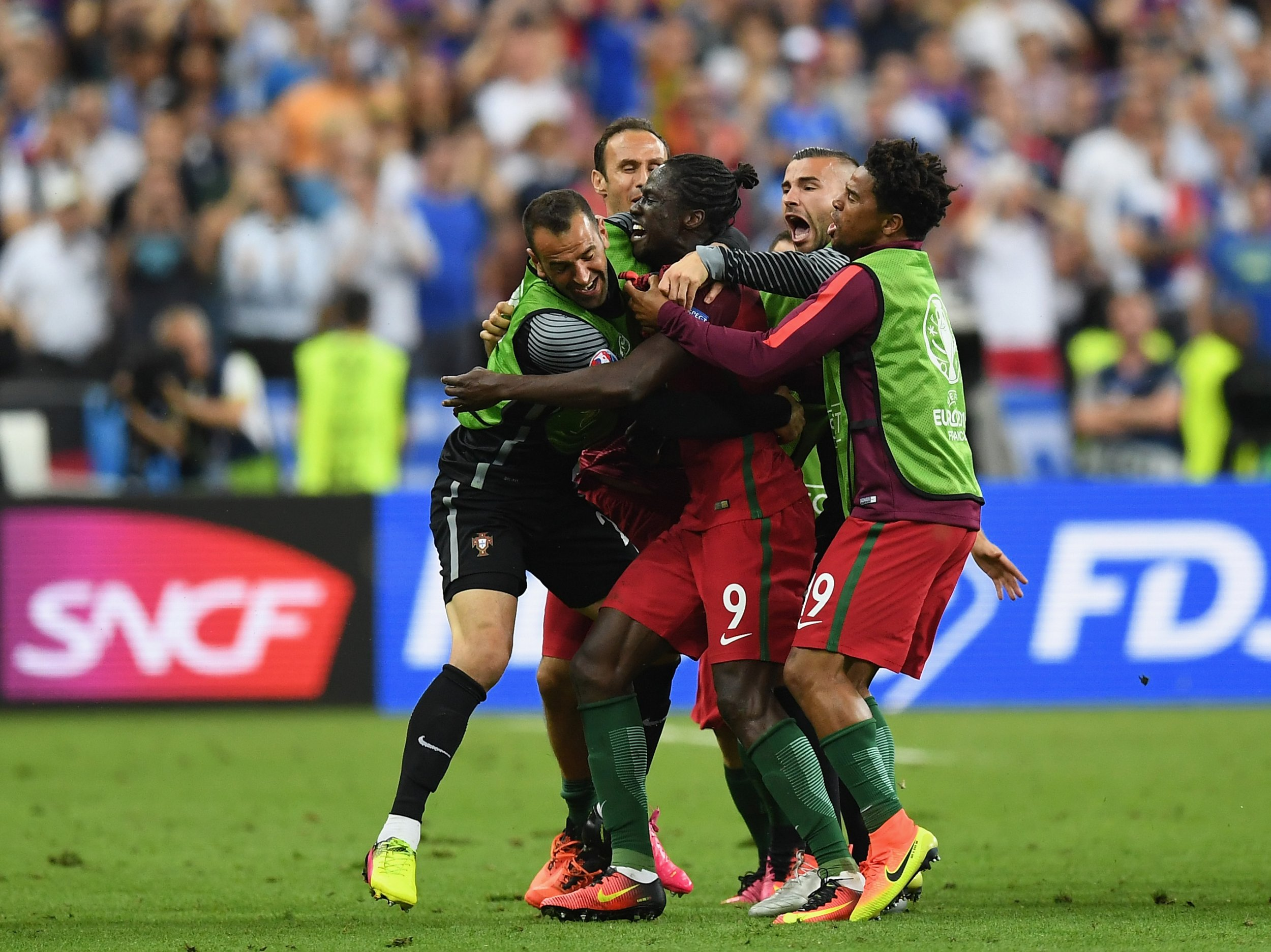 Portugal players celebrate the winning goal of Eder, center.