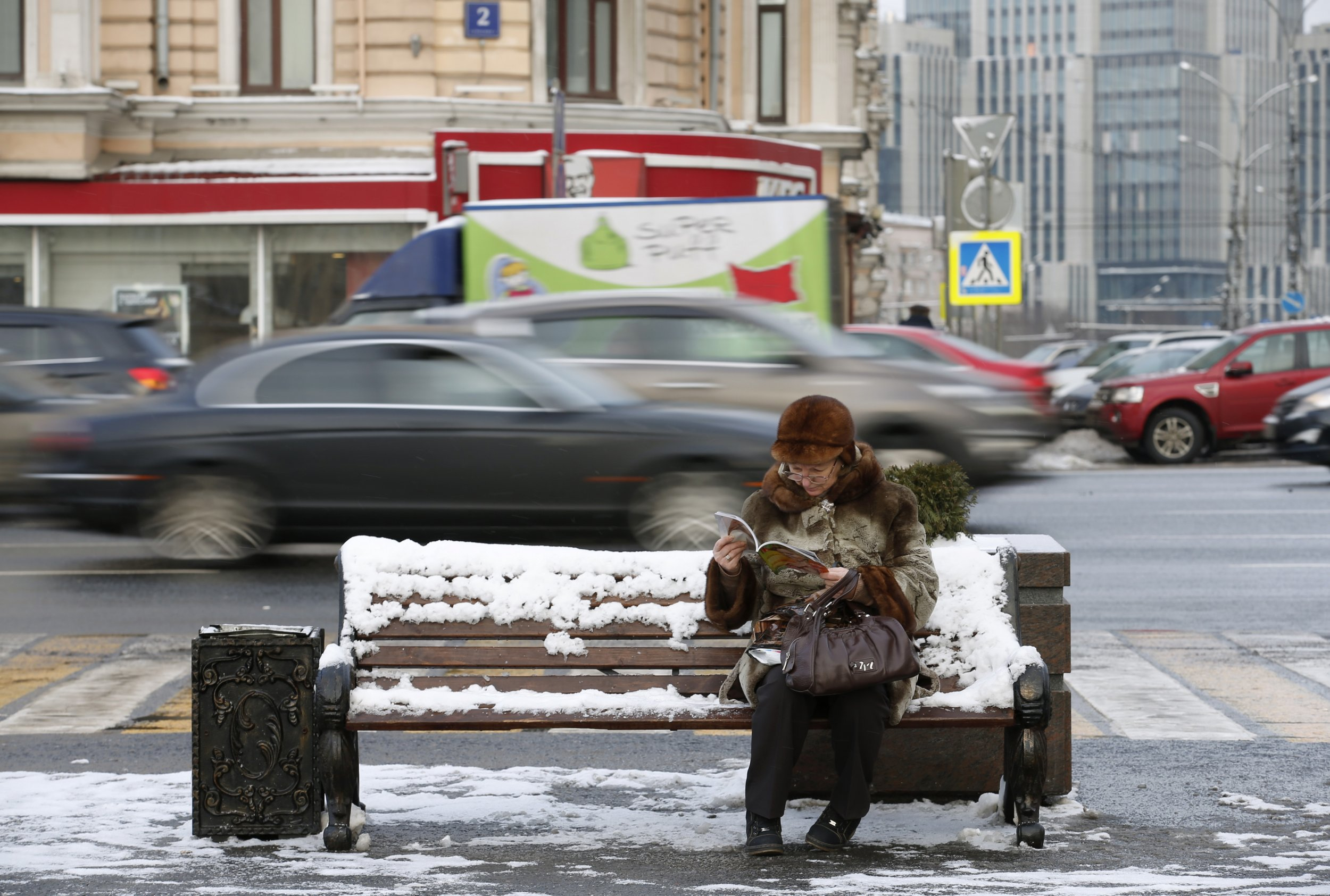 Woman reads magazine in Moscow