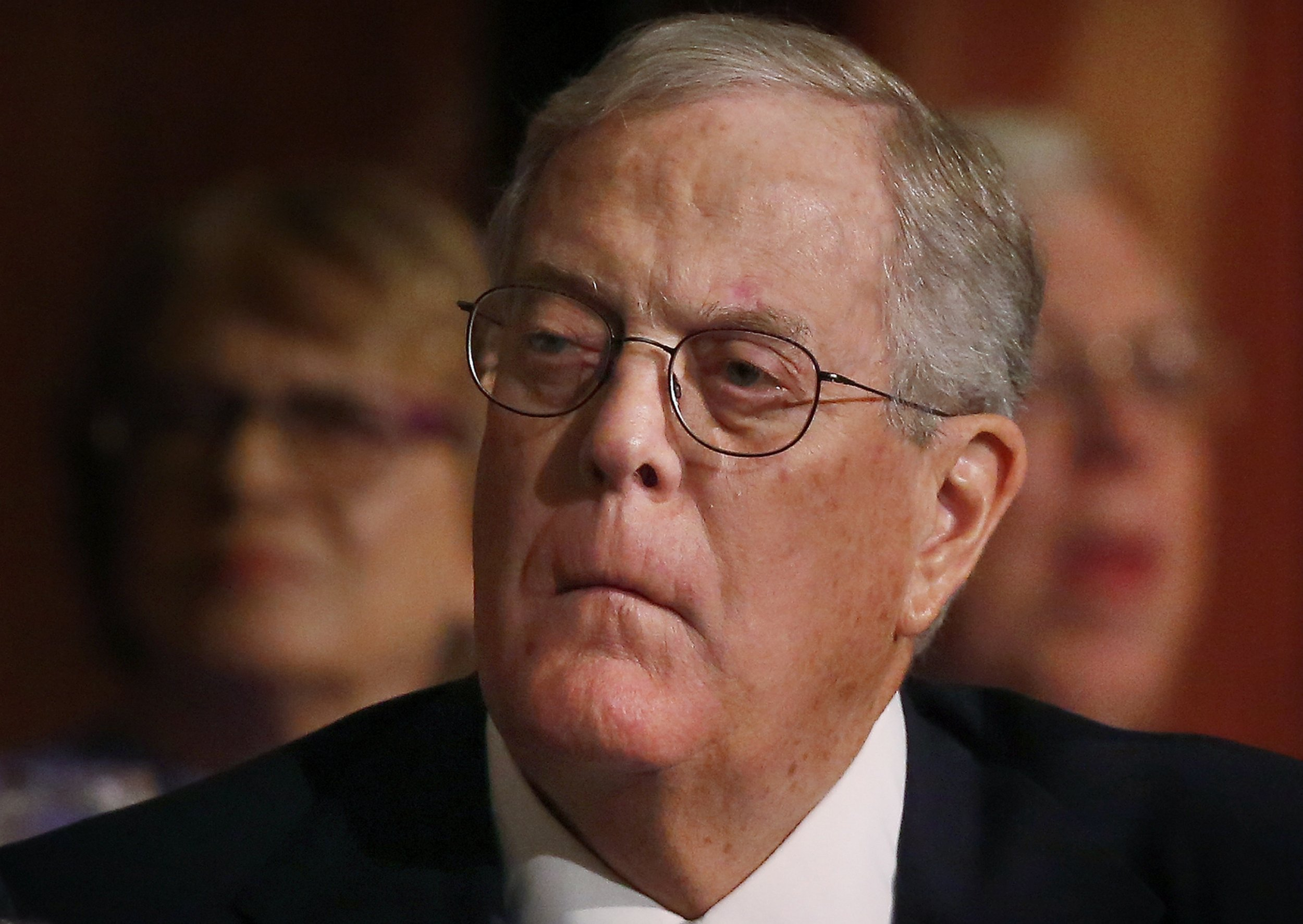 Koch brothers funded dark money groups slapped with fines for David charles koch