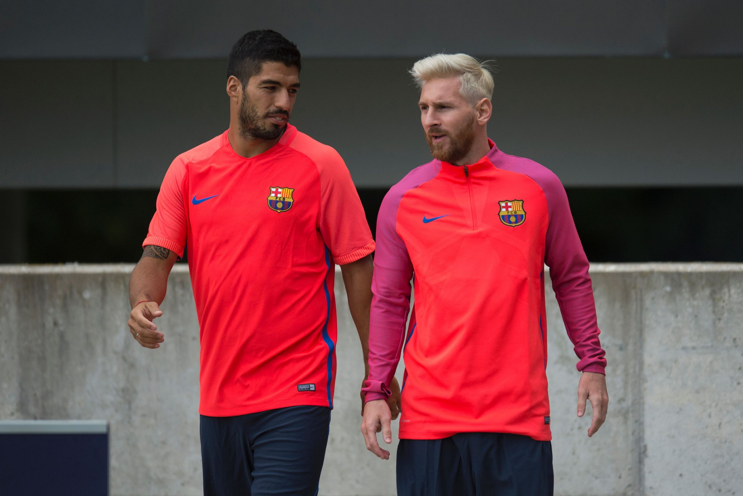 Lionel Messi, right, of Barcelona, with Luis Suarez.