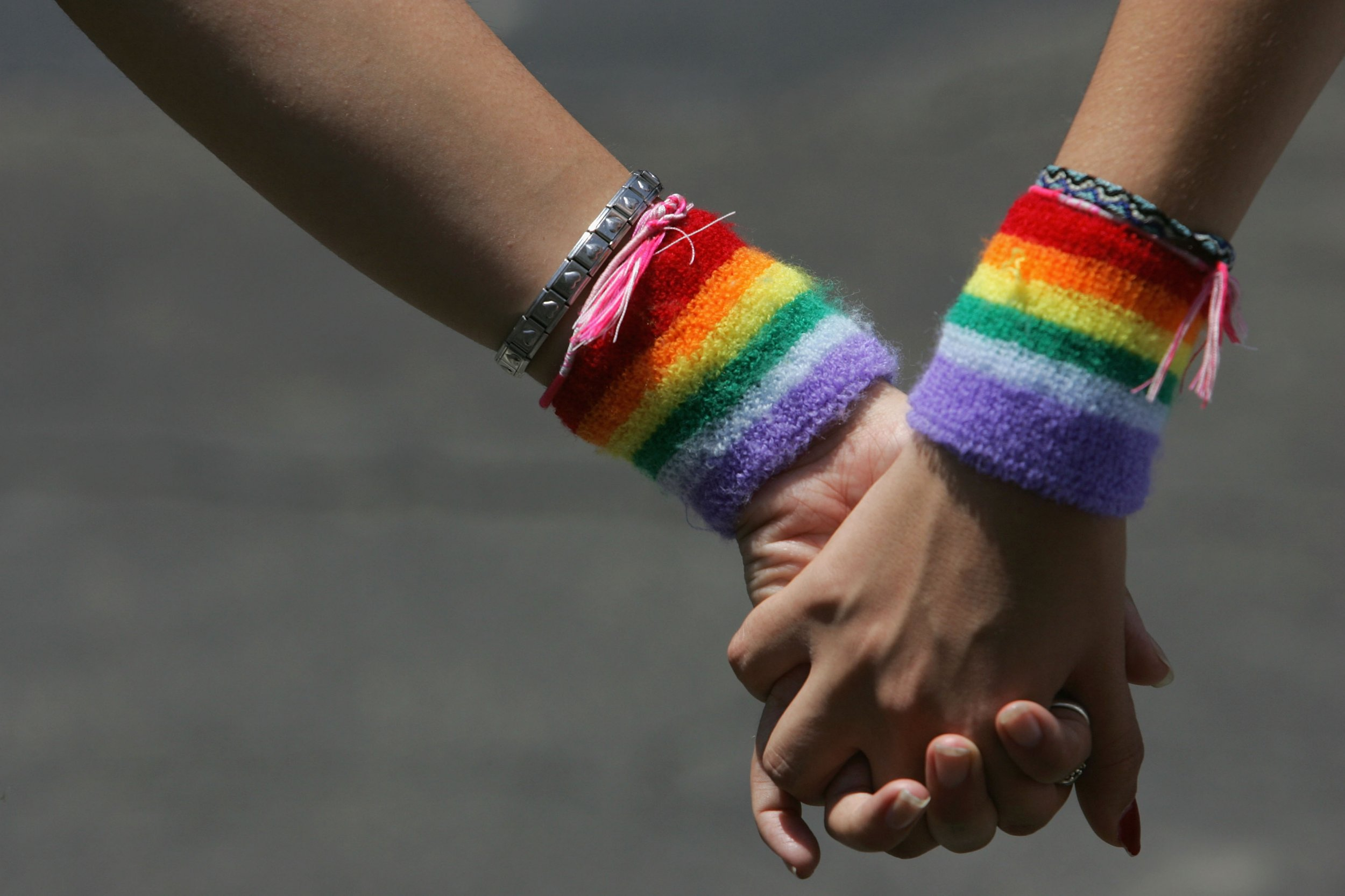 A lesbian couple hold hands