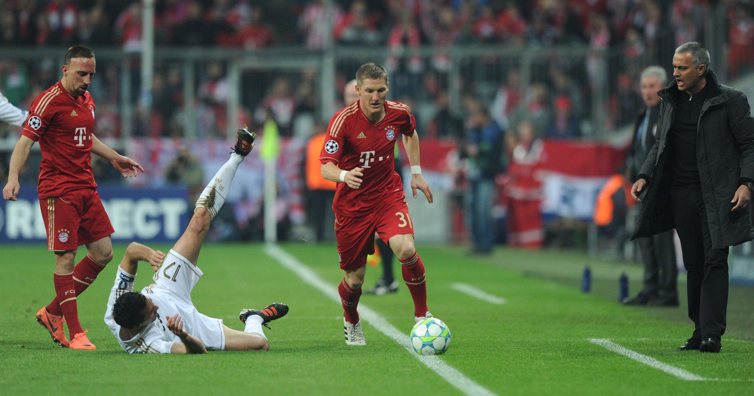 Bastian Schweinsteiger, center, with Jose Mourinho, right.