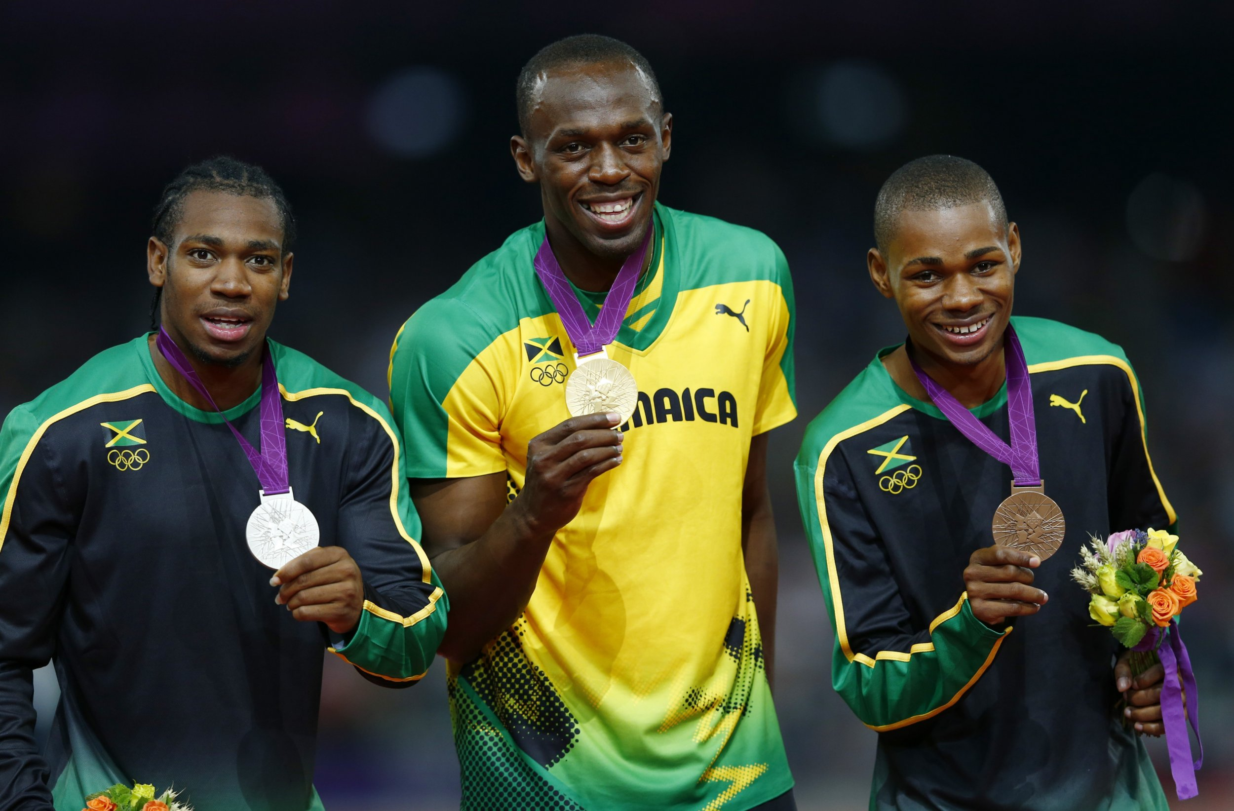 Blake, Bolt and Warren Weir at the 200-meter medal ceremony, London 2012