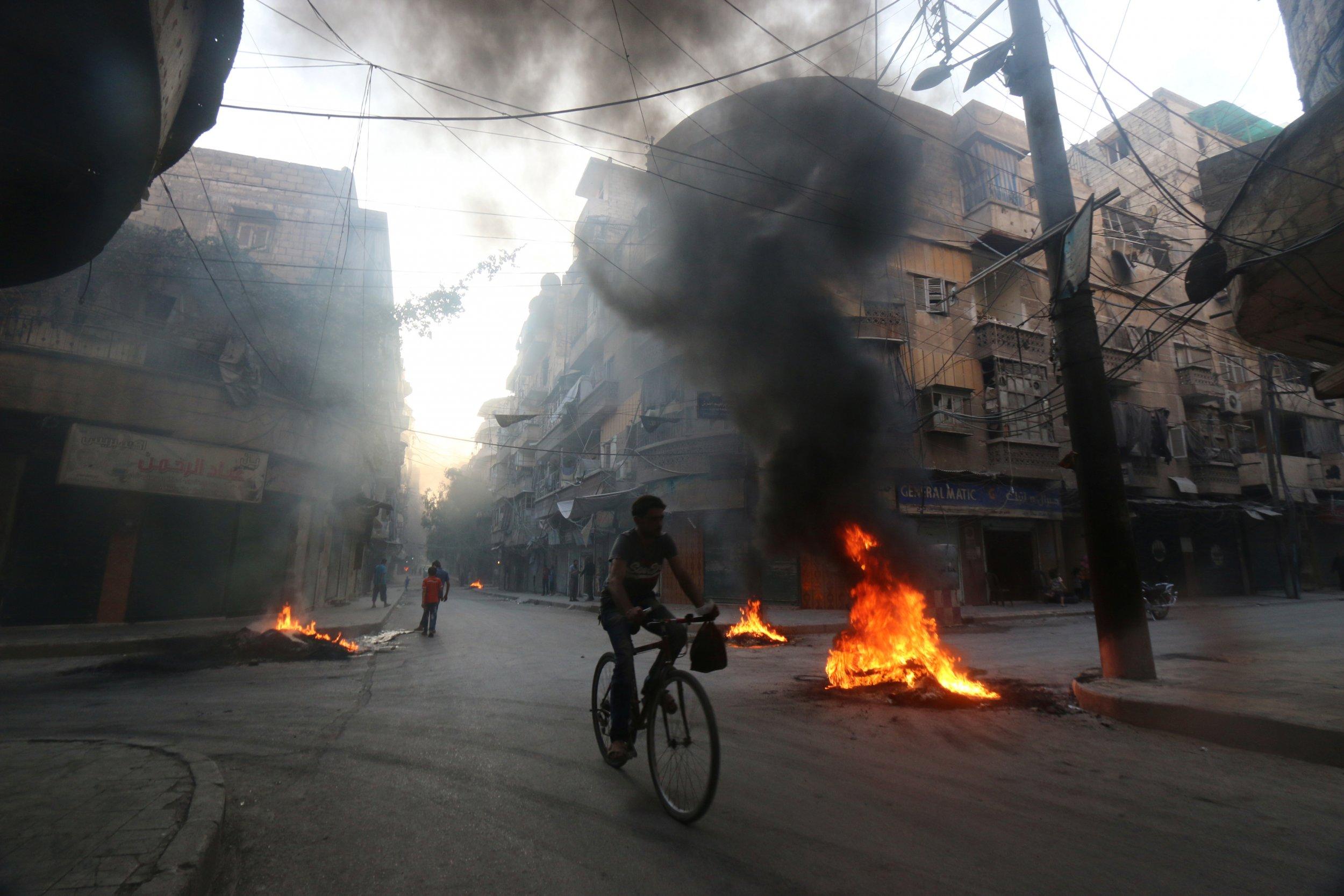 Tires burn in Aleppo