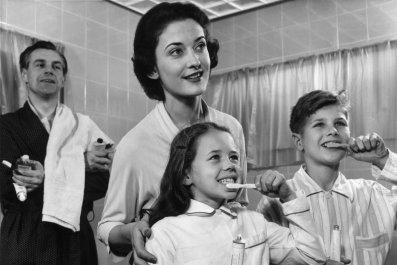 A family cleaning their teeth, circa 1955