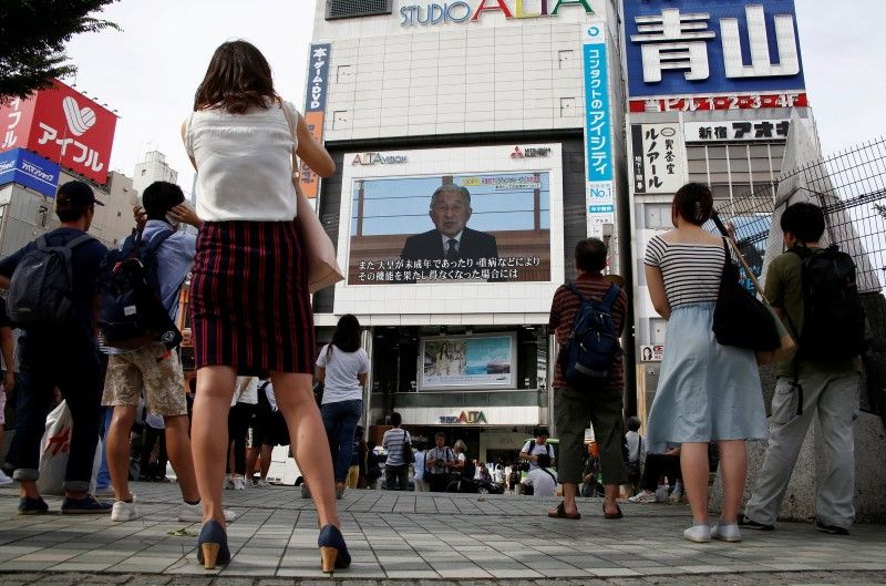 People watch a large screen in Tokyo, Japan