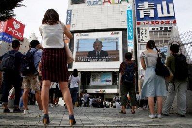 People watch a large screen in Tokyo, Japan