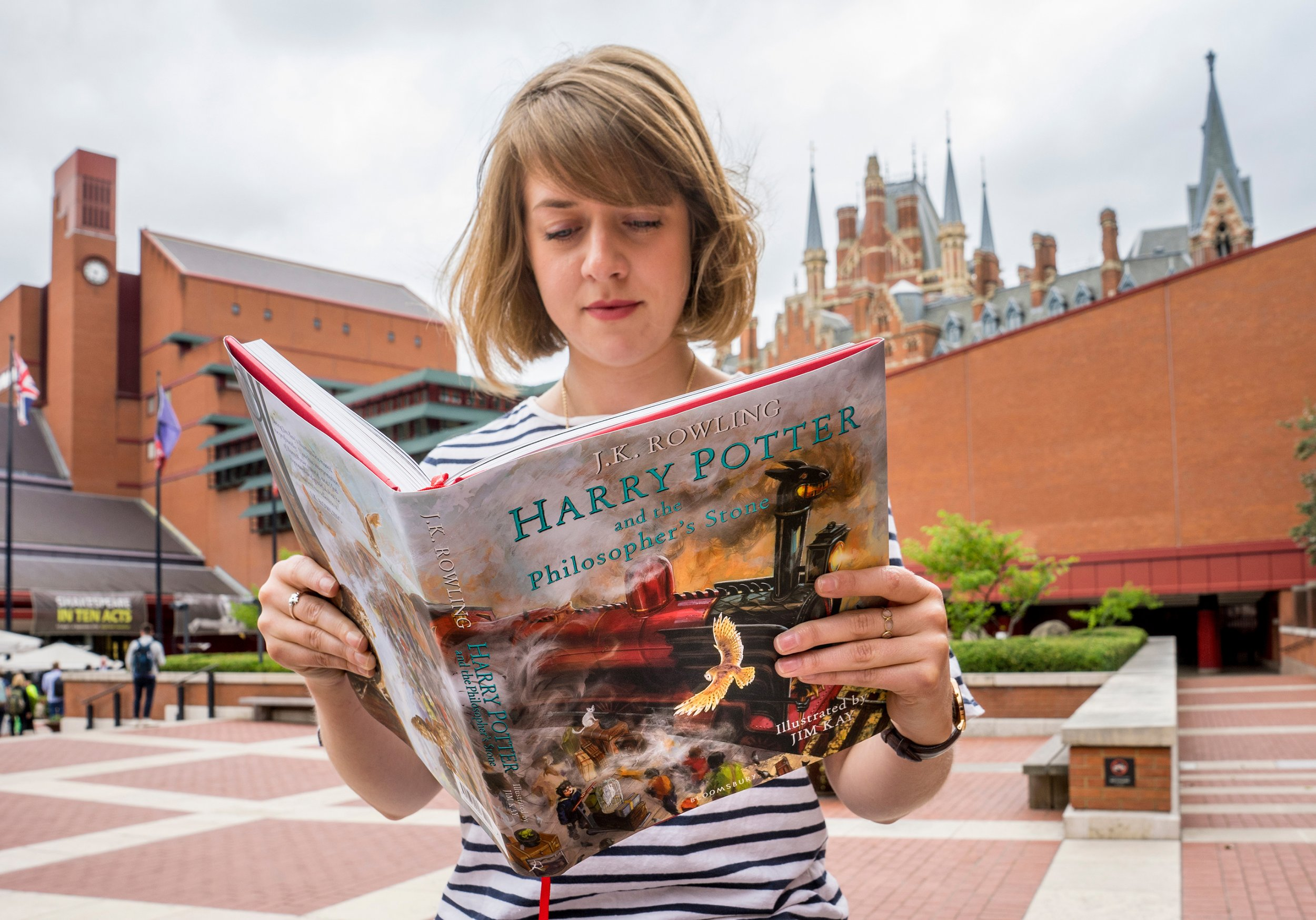 """A fan reads the illustrated edition of """"Harry Potter and the Philosopher's Stone"""""""