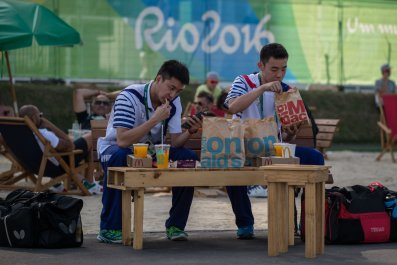 Athletes eating fast food at the Olympics