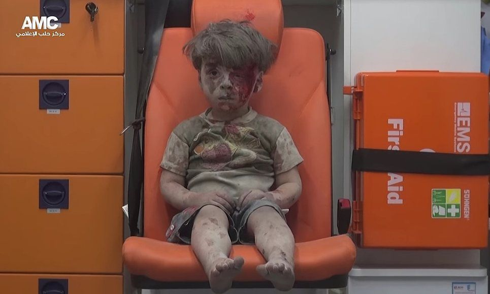 Syria Boy After Aleppo Air Strike