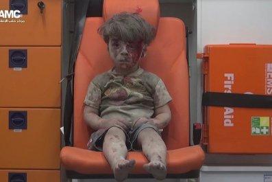 Syria Boy After Aleppo Air Strike