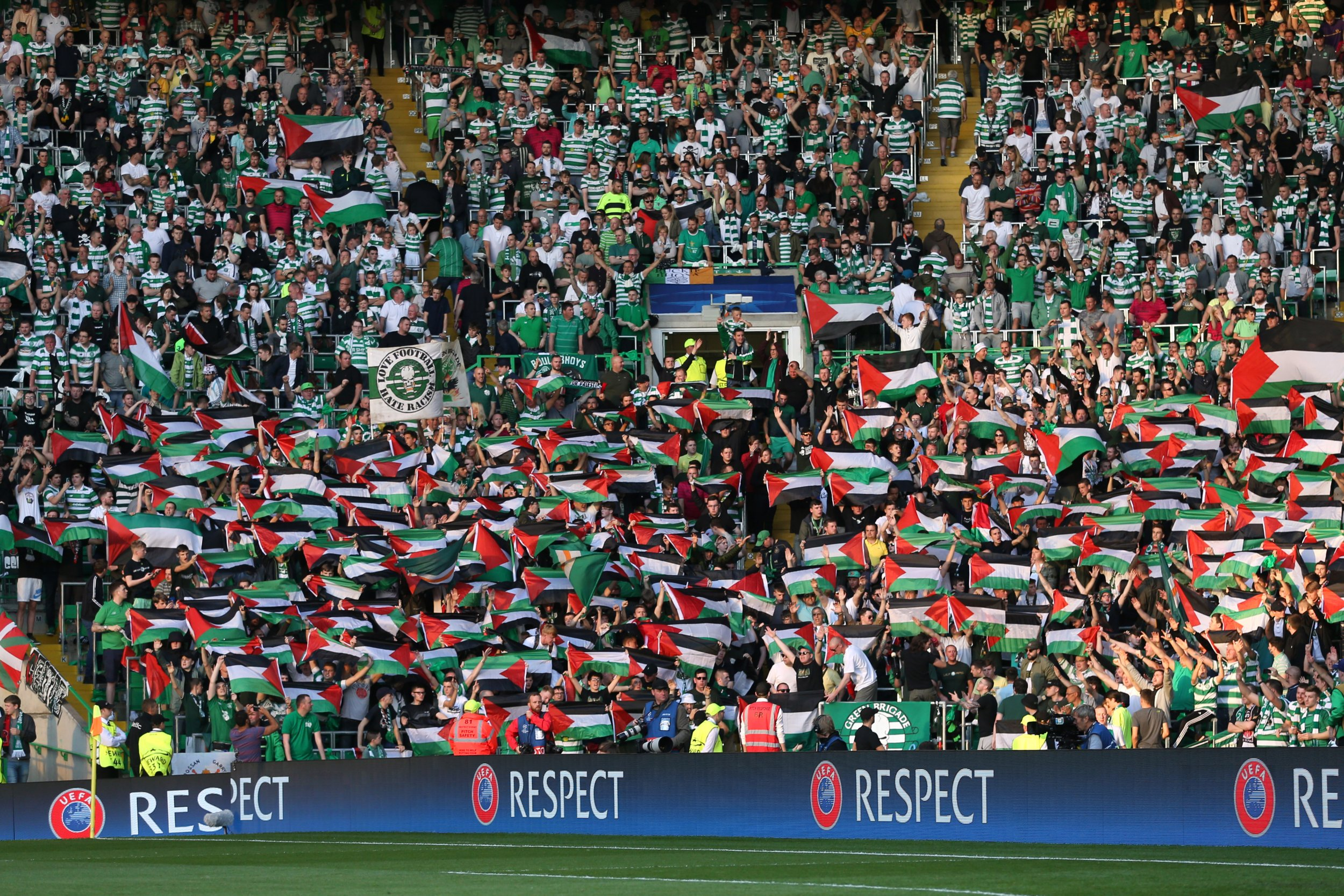 Celtic Fans hold up flags against Hapoel Beer Sheva