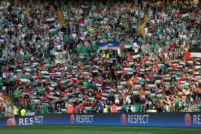 Celtic Fans hold up flags against Hapoel Beer Sheva