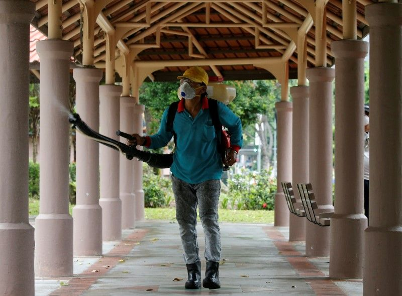 A worker in Singapore after Zika cases
