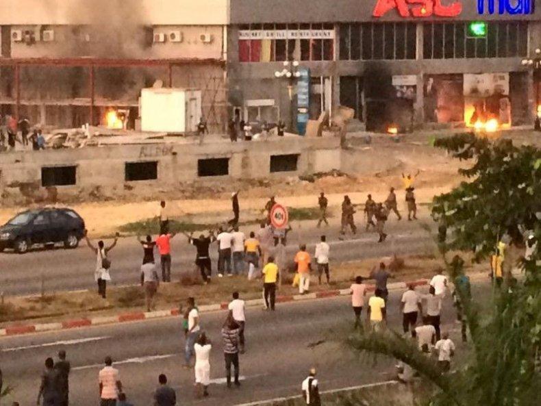 Gabon soldiers patrol a street near opposition HQ