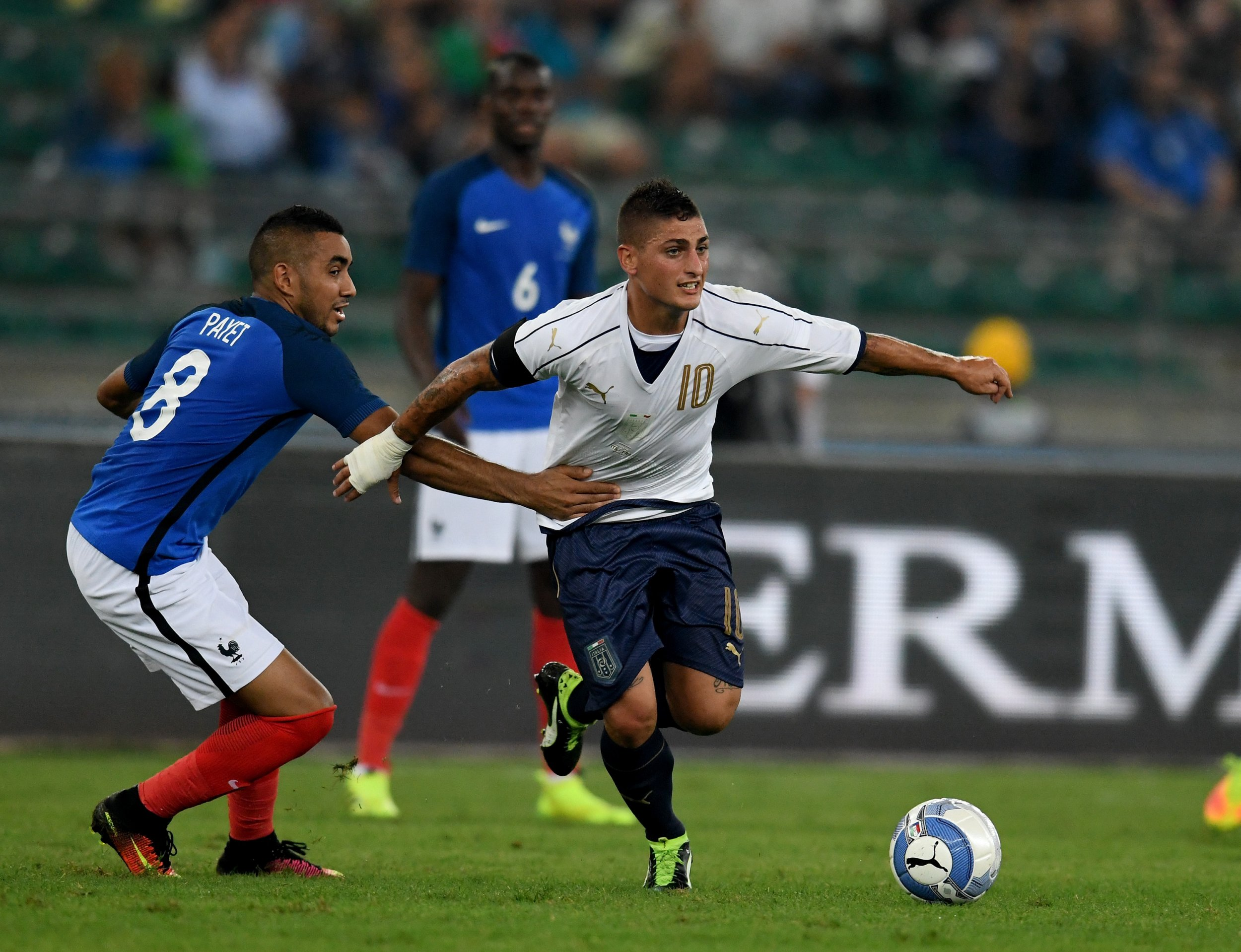 Marco Verratti, right, with Dimitri Payet.