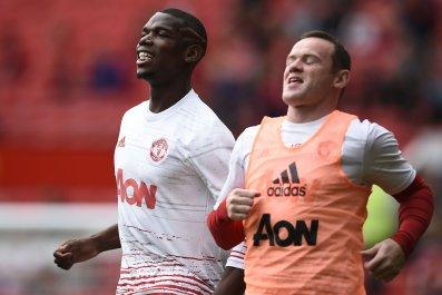 Paul Pogba, left, with Wayne Rooney.