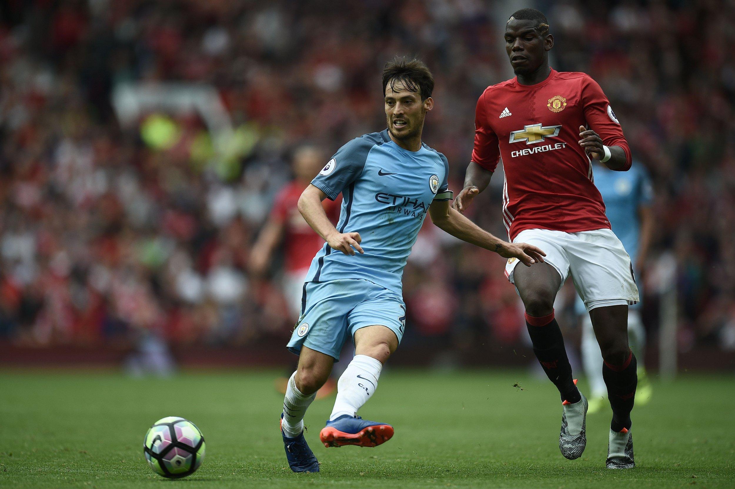 Manchester United midfielder Paul Pogba, right.