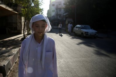 Syria boy walks in Douma