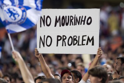 A fan holds up a sign referring to then-Chelsea manager José Mourinho in Florida, August 2013.