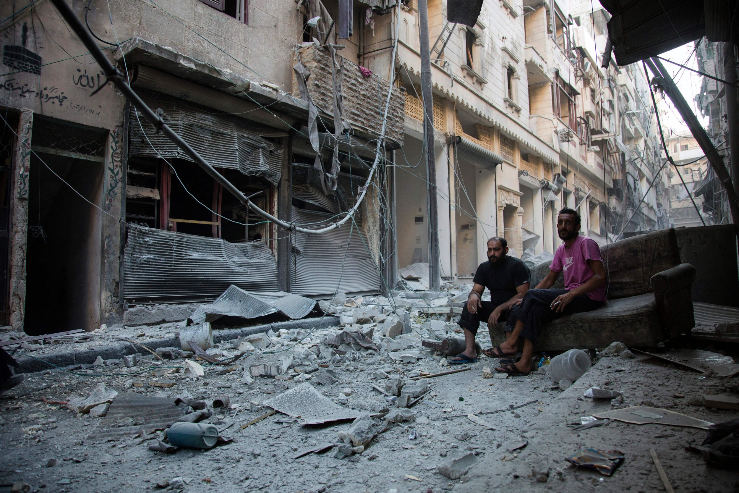 Syria men in Aleppo before ceasefire expiration