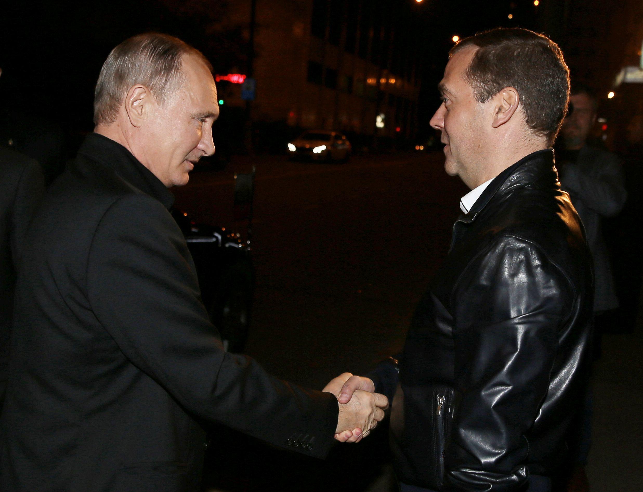 Vladimir Putin greets Dmitry Medvedev