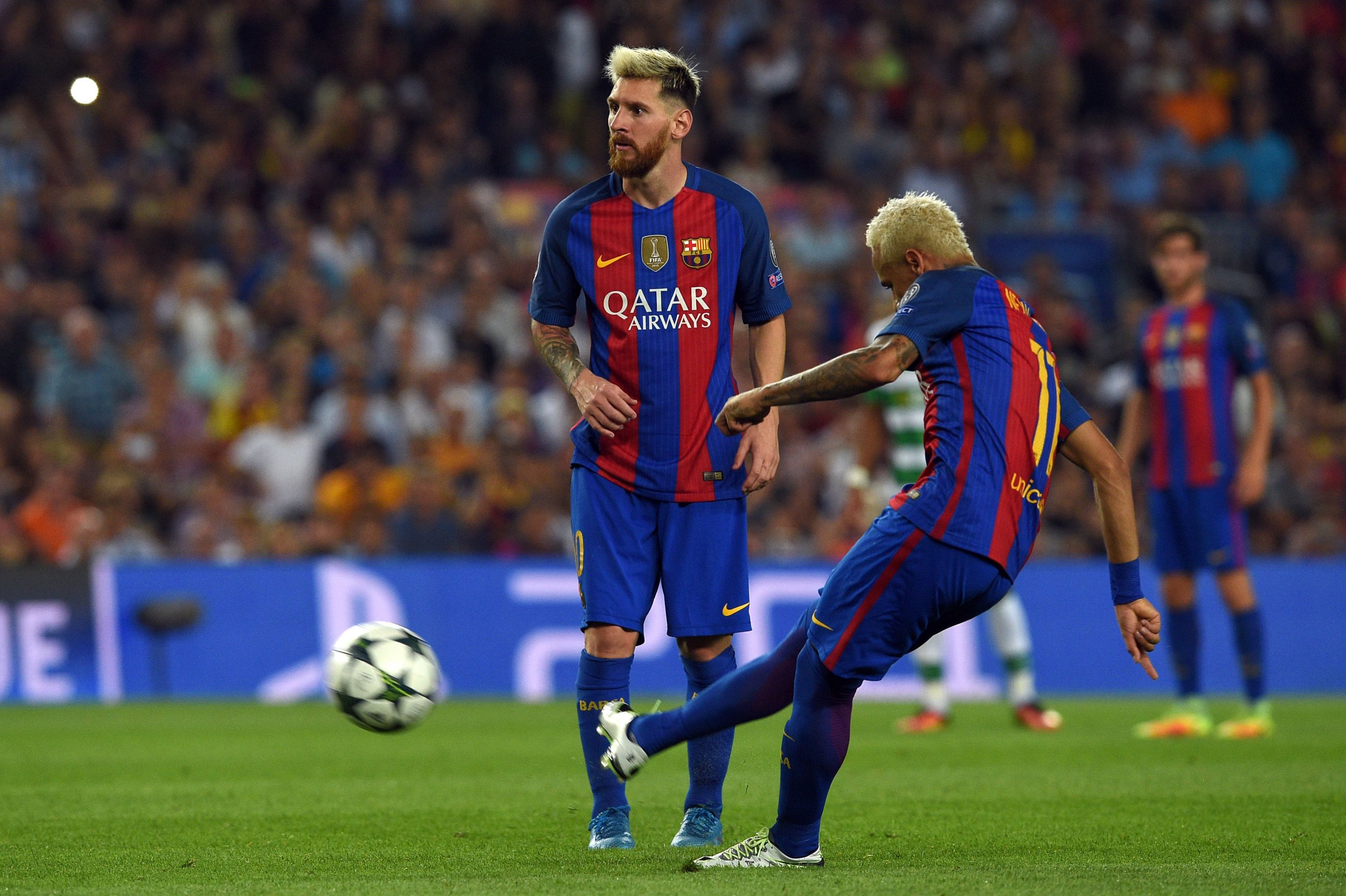 Lionel Messi, left, with Barcelona team mate Neymar.