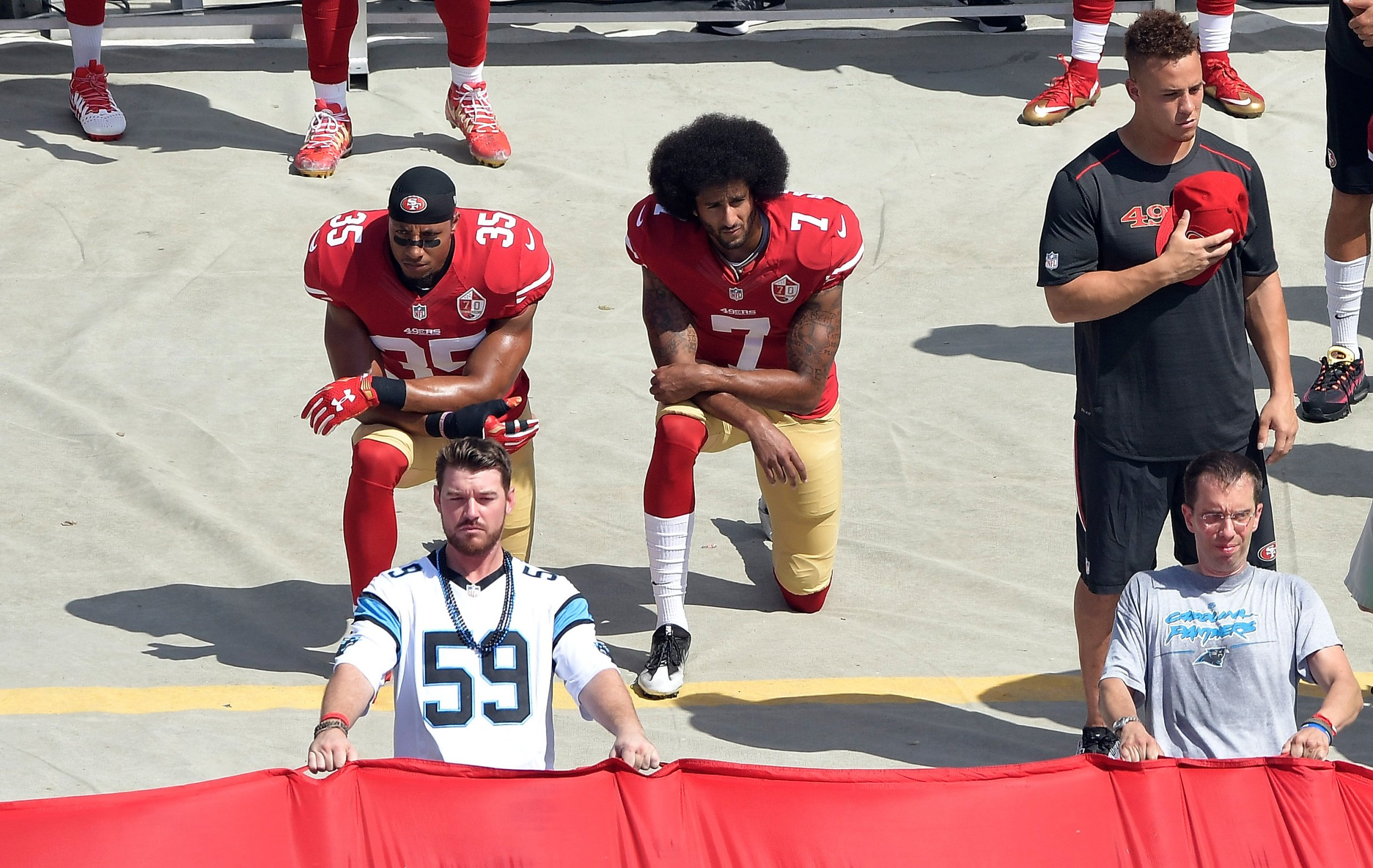 San Francisco 49ers quarterback Colin Kaepernick, center.