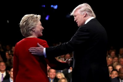 Hillary Clinton shakes hands with Donald Trump