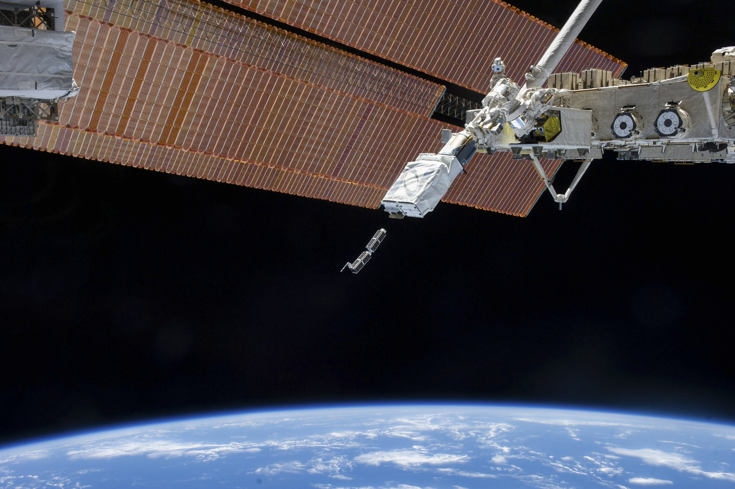 Small Satellite Orbital Deployer in space with CubeSats