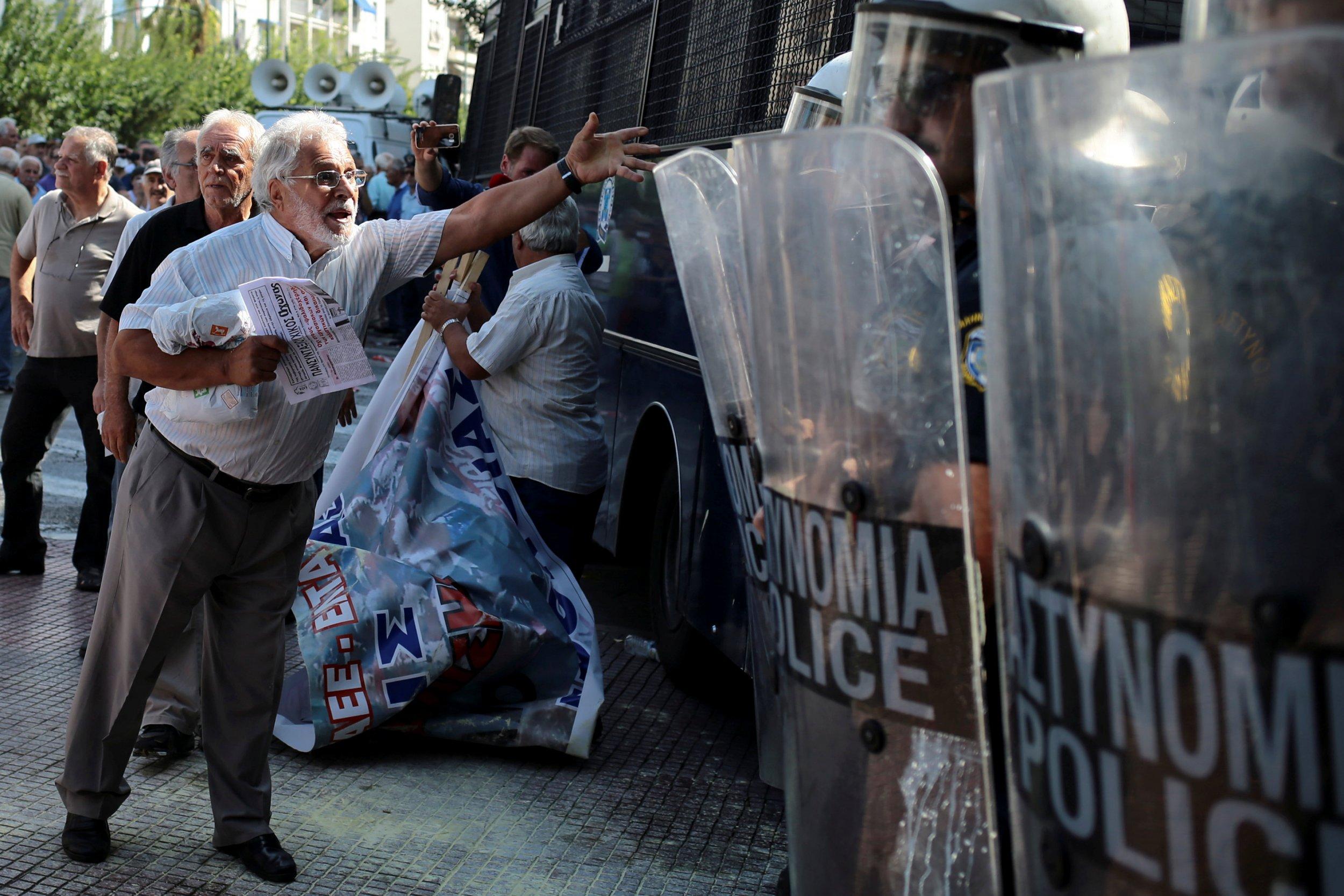 A Greek pensioner protests pension cuts