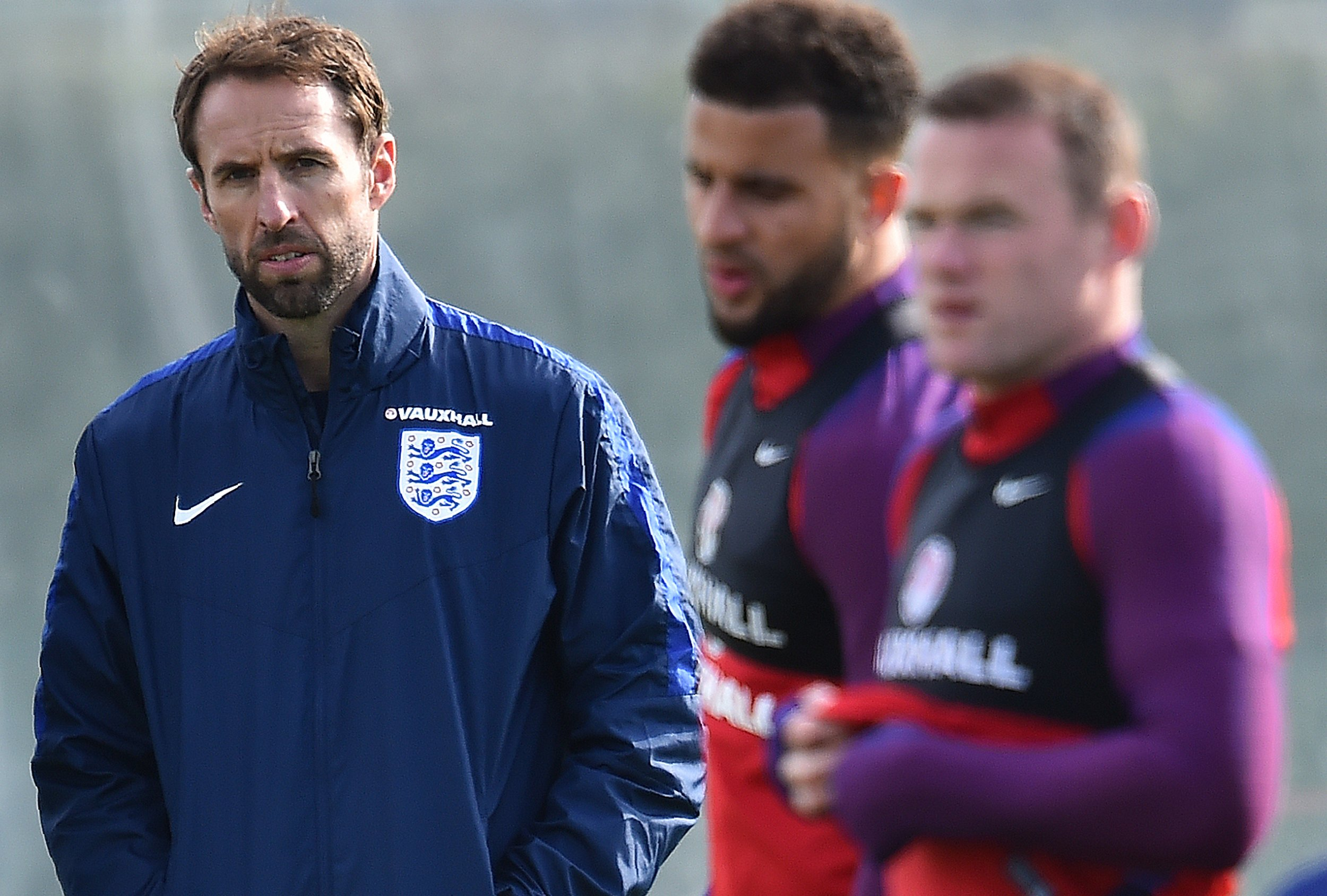 England interim manager Gareth Southgate, left, with captain Wayne Rooney, right.