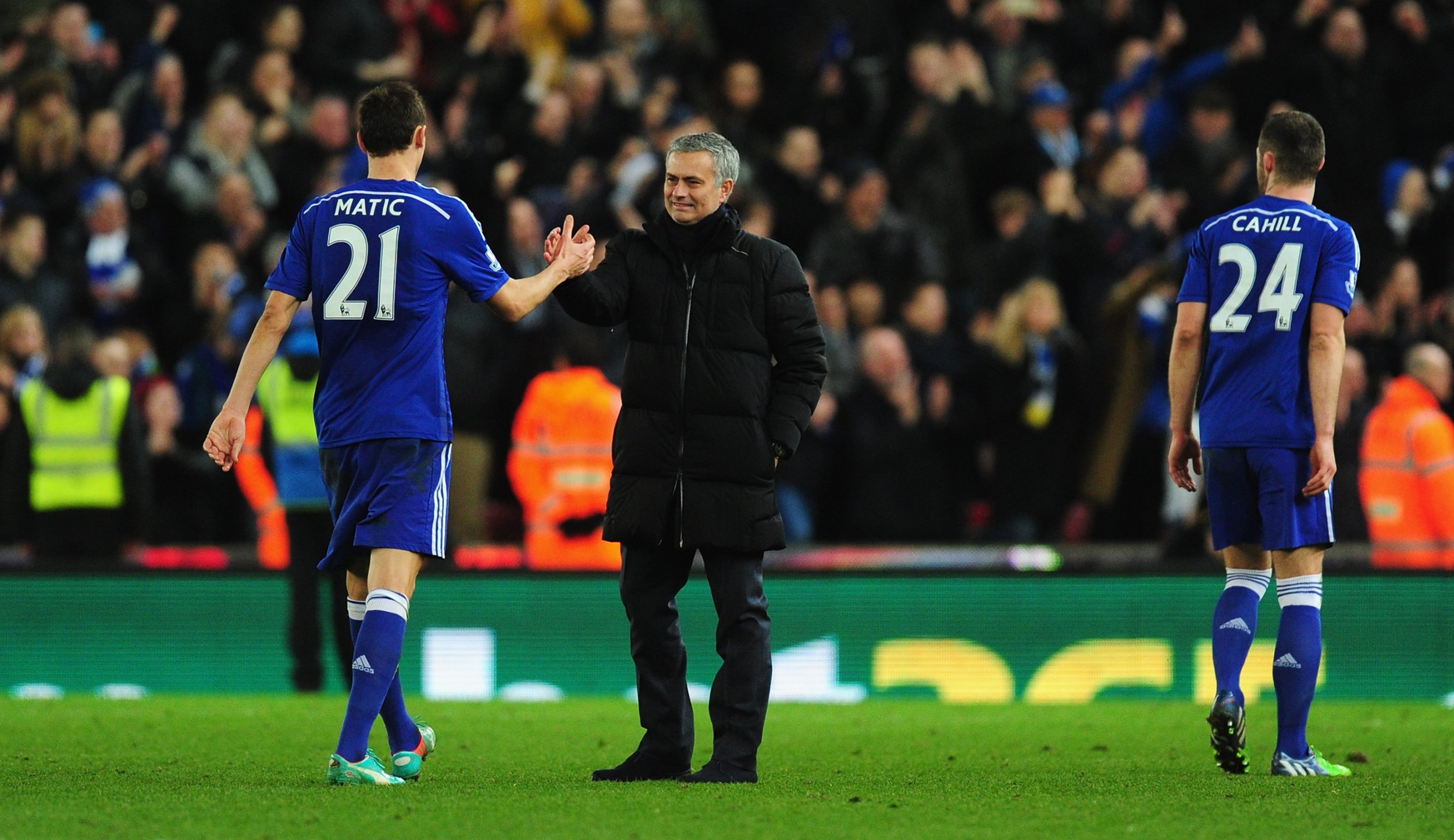 Former Chelsea manager Jose Mourinho, center, with Nemanja Matic, left.