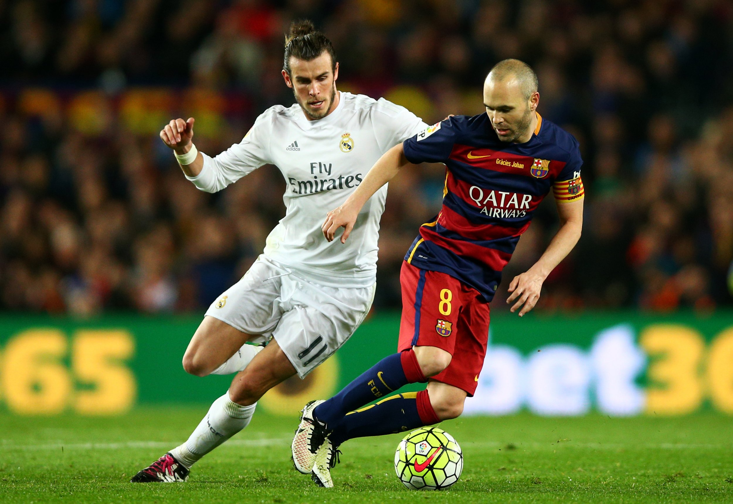 Real Madrid's Gareth Bale, left, with Barcelona's Andres Iniesta.