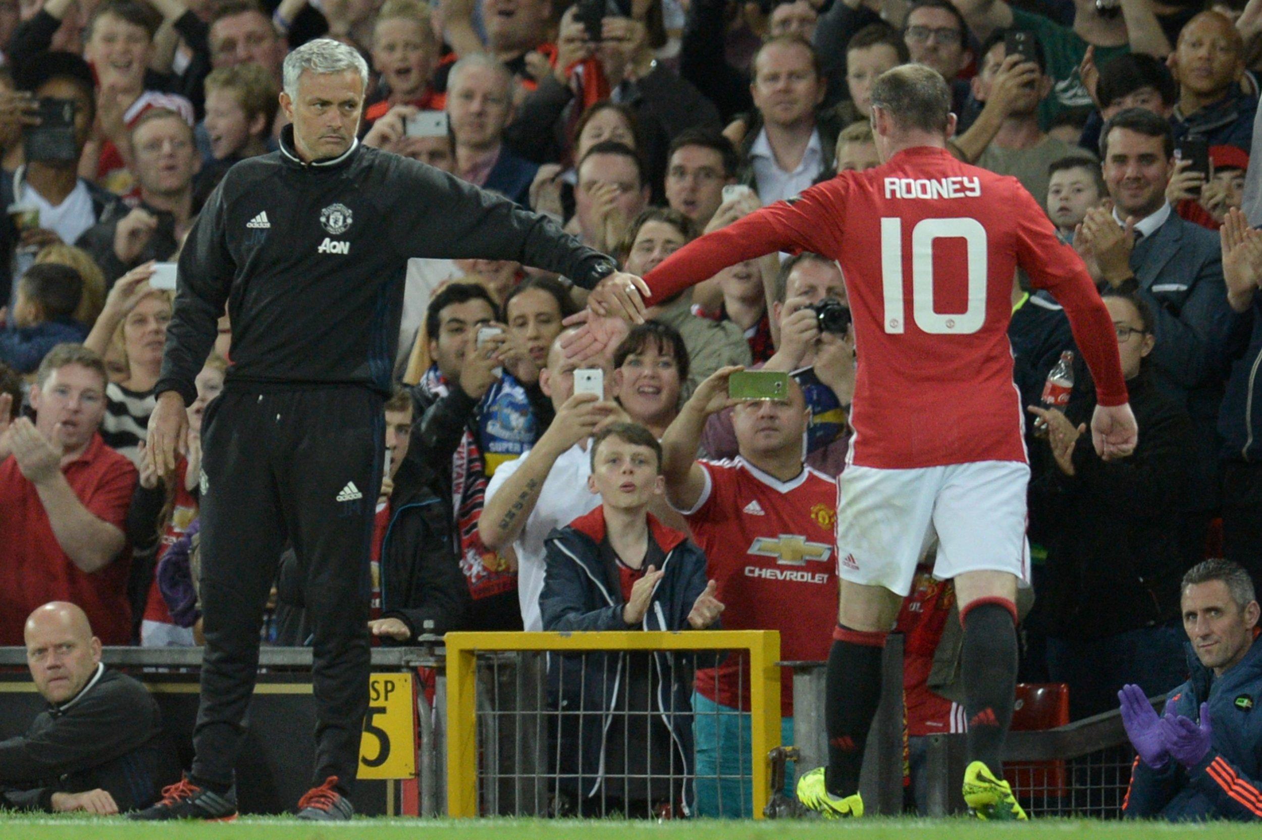 Manchester United manager Jose Mourinho, left, with Wayne Rooney.