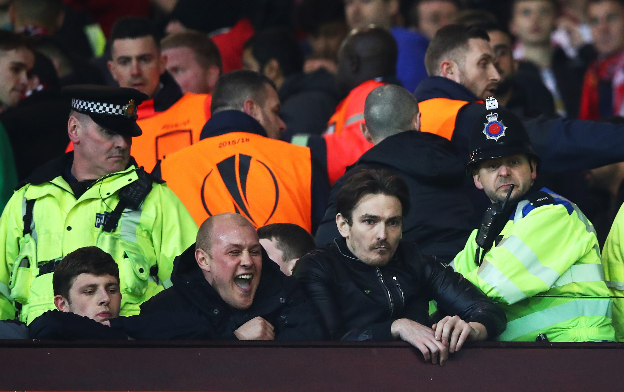 Fans look on after the UEFA Europa League round of 16, second leg match between Manchester United and Liverpool, March 17.