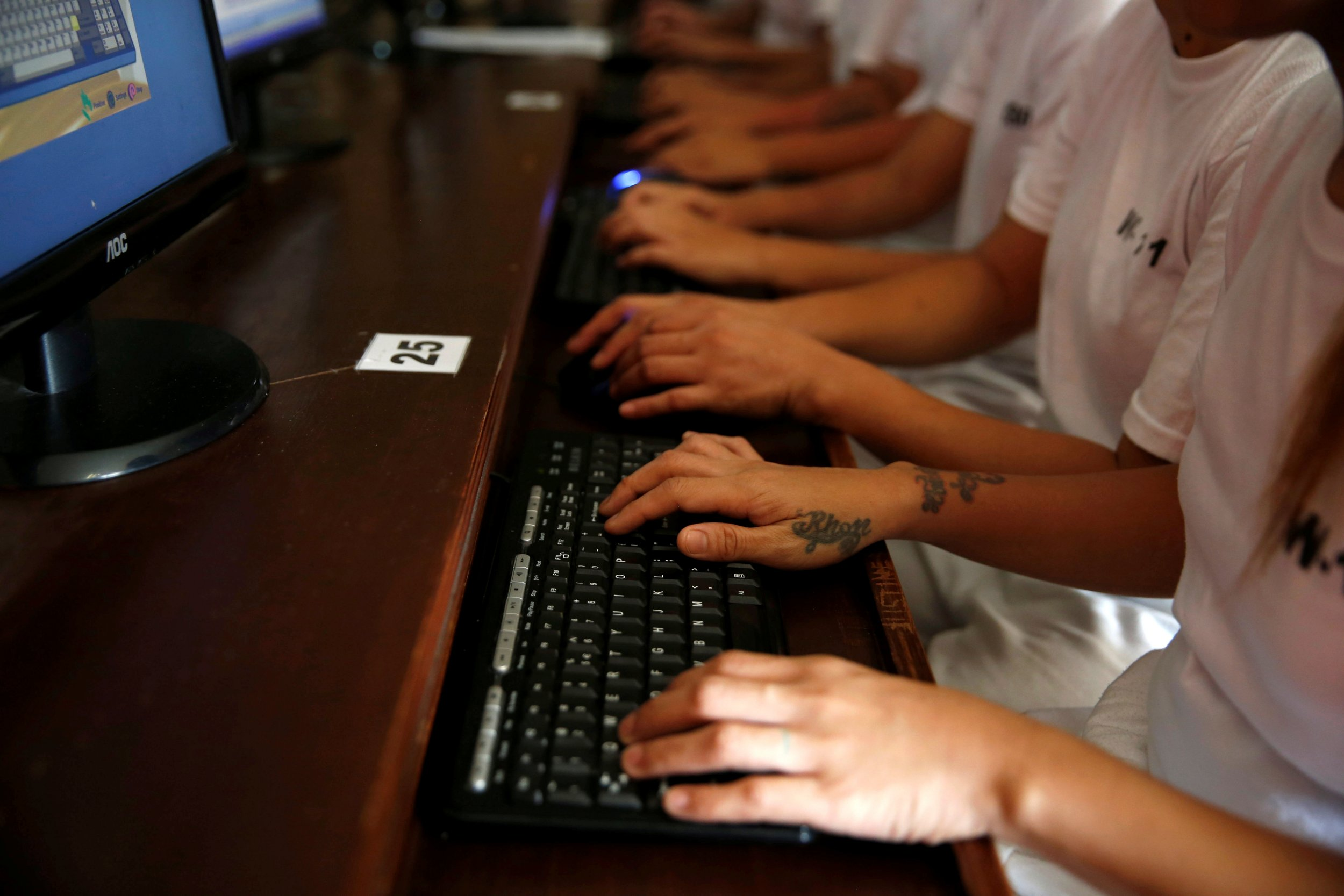 Drug users typing on computers