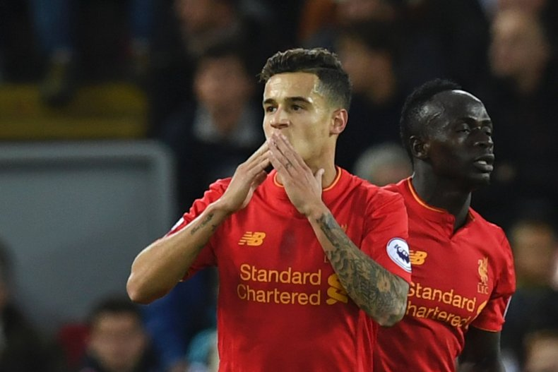 Liverpool star Philippe Coutinho, left, with Sadio Mane.