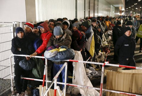 Refugees queue outside a Berlin registration office