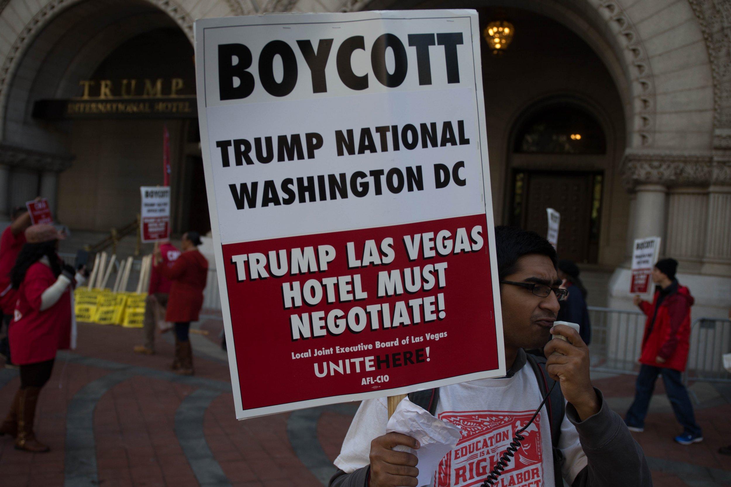 Demonstrators gather outside of the Trump International Hotel Washington.
