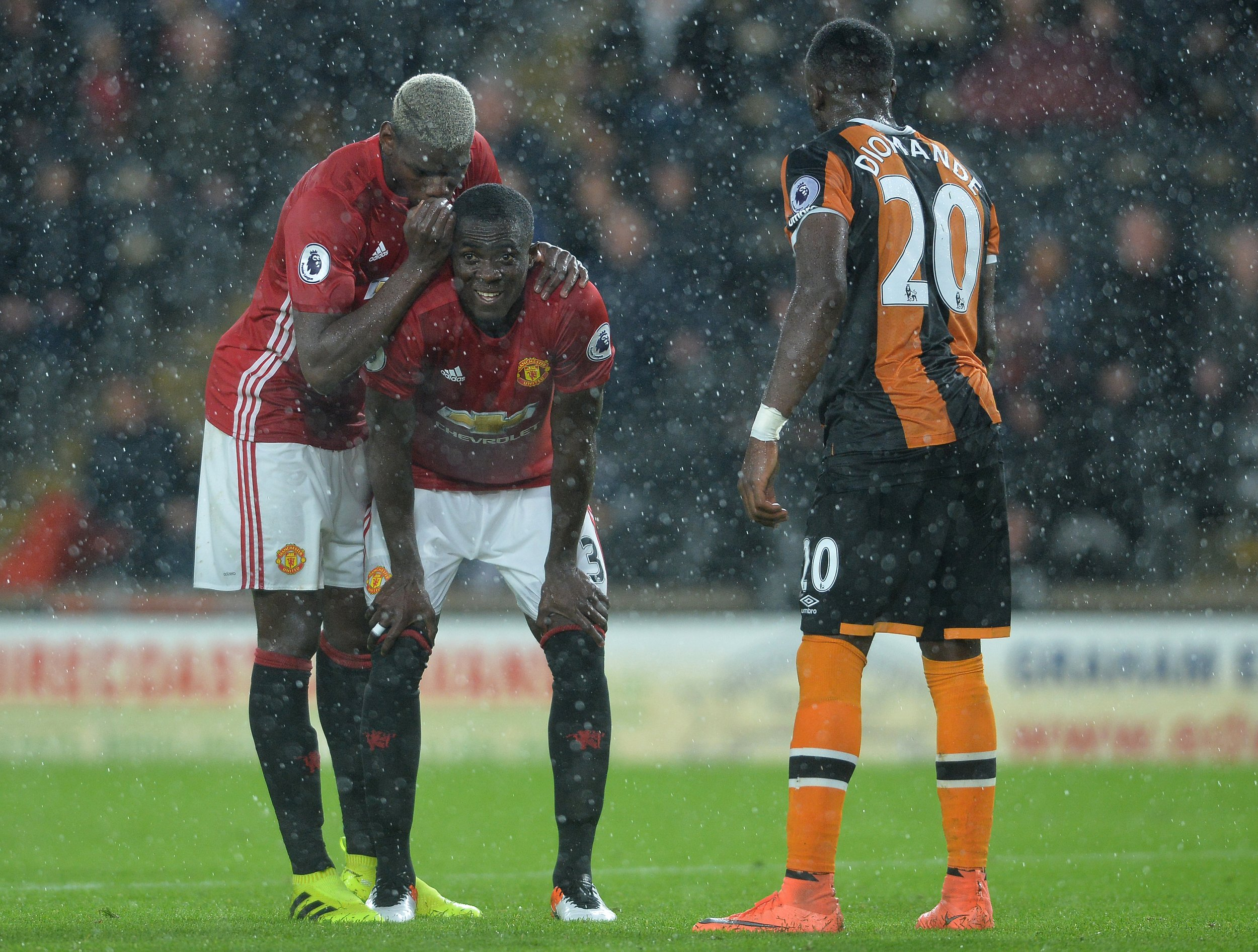 Paul Pogba, left, and Eric Bailly, second from left, of Manchester United at KC Stadium, Hull.
