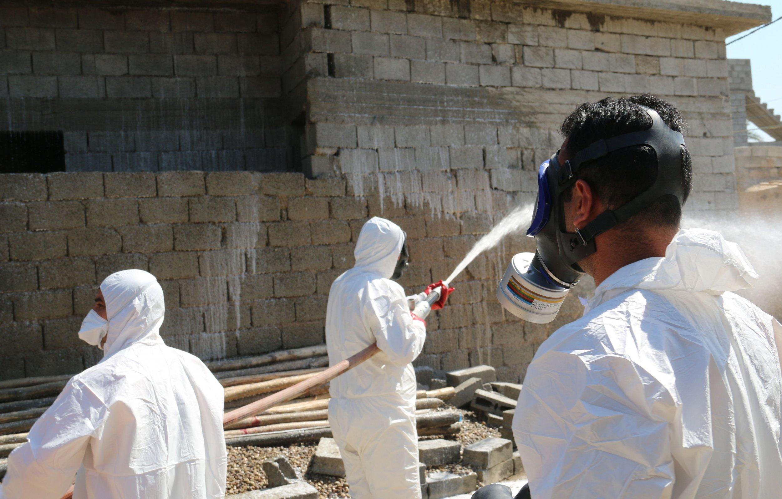 Iraqi civil defence spray areas
