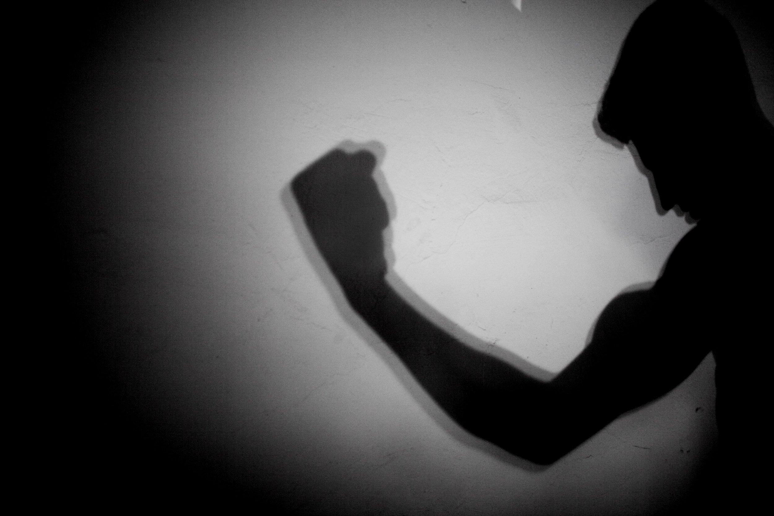 A bodybuilder flexes his muscles