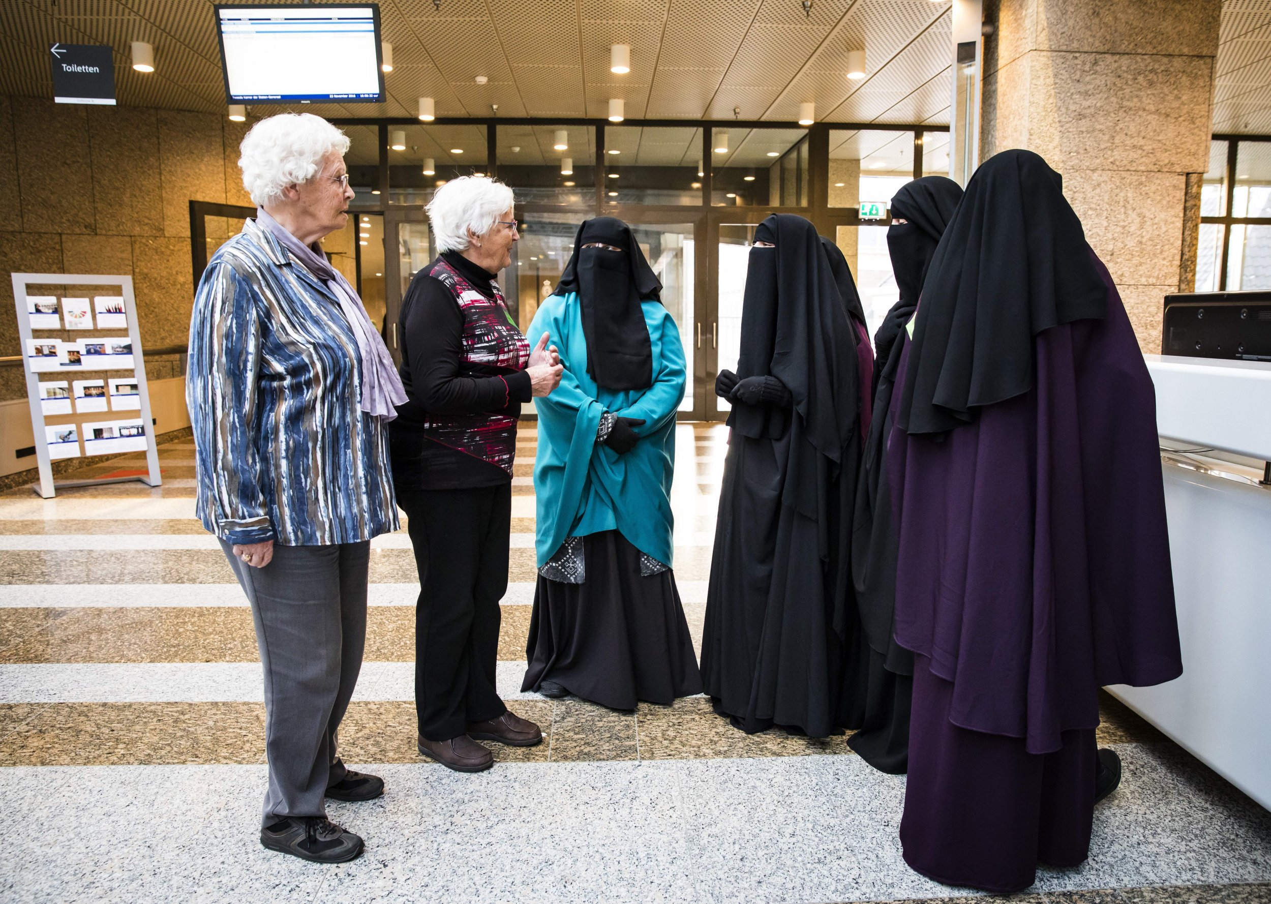 Women adorning the niqab attend the Dutch Senate