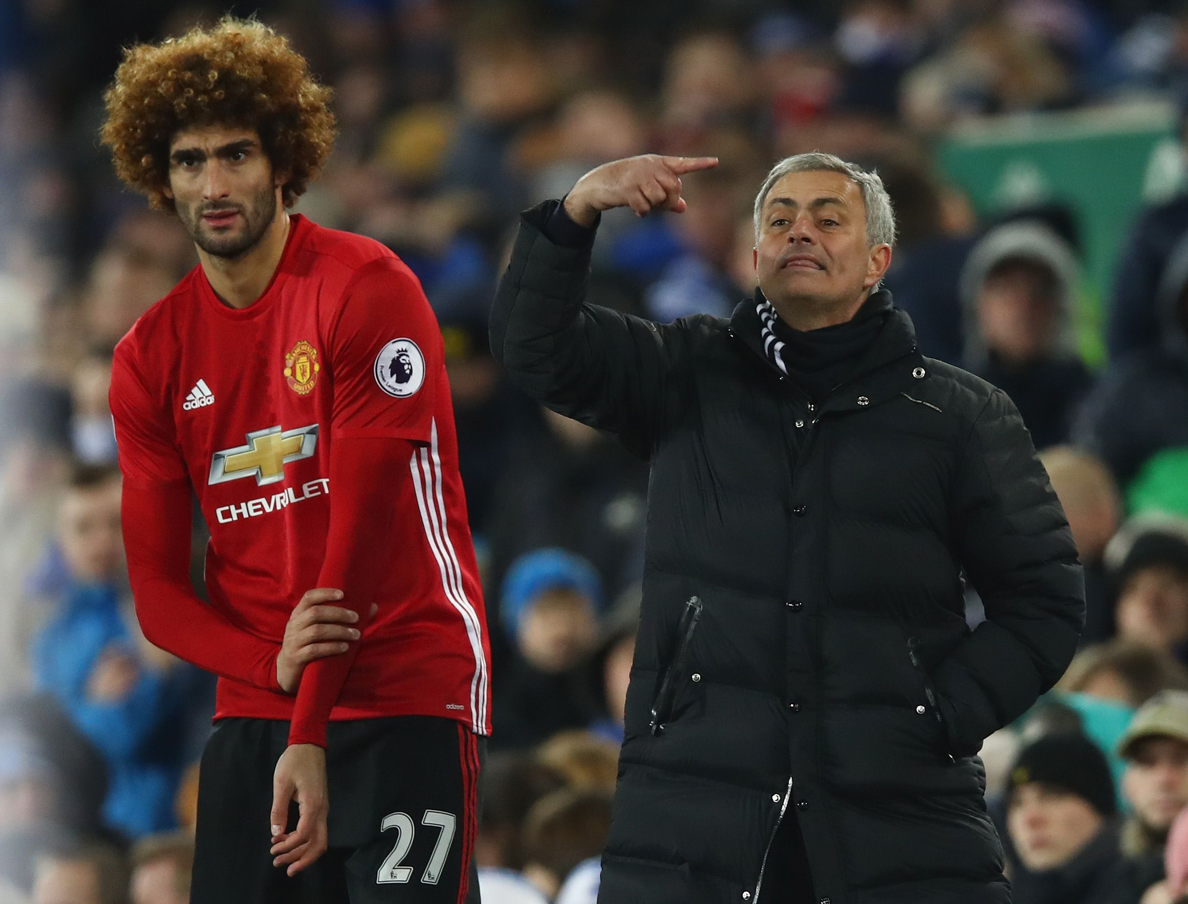 Manchester United's Marouane Fellaini, left, with Jose Mourinho.