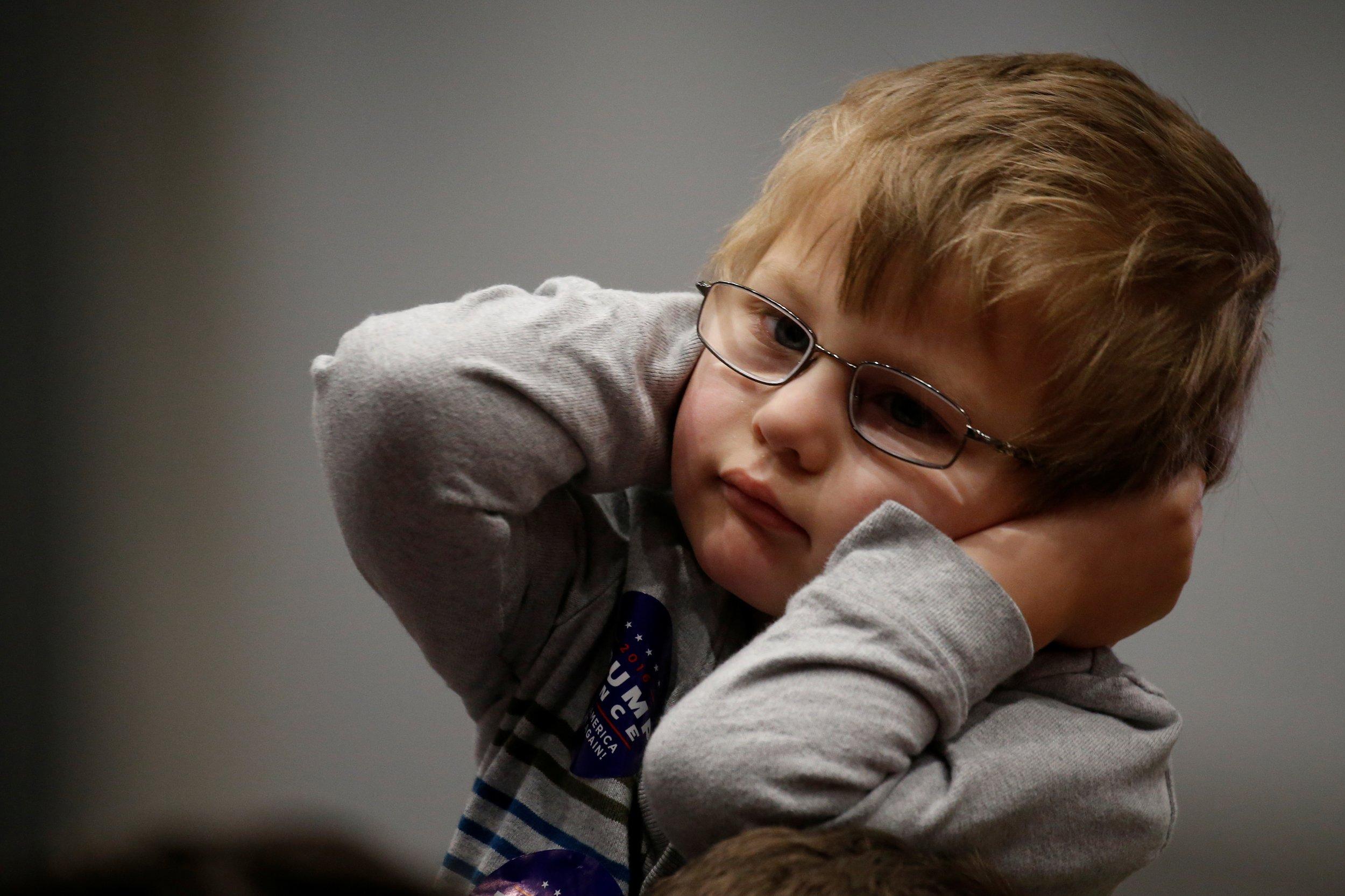 Child listening to Donald Trump