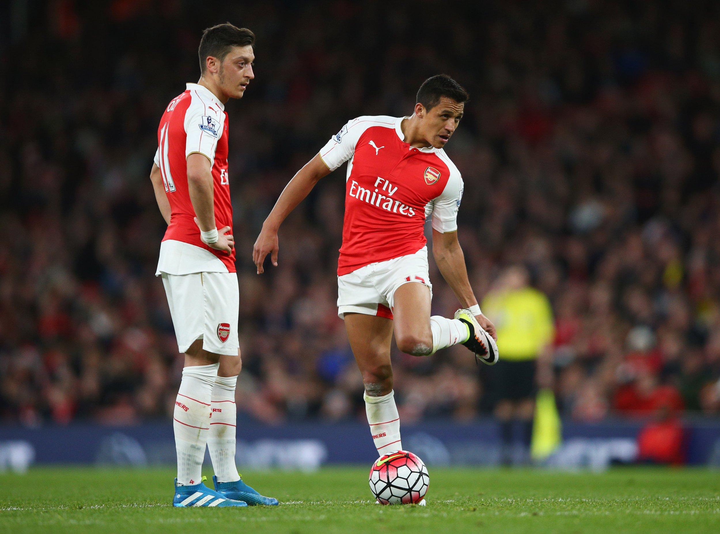 Mesut Ozil, left, with Alexis Sanchez