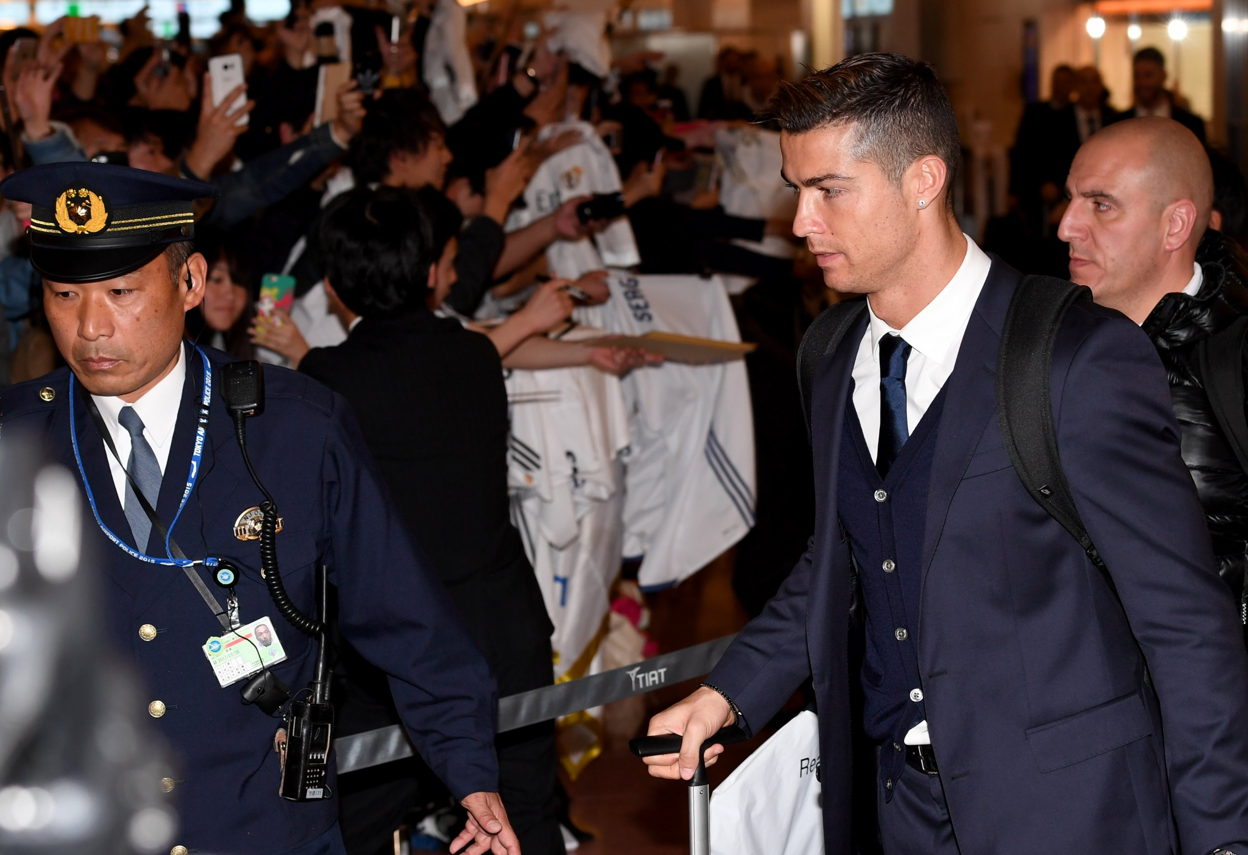 Real Madrid star Cristiano Ronaldo, right, at the Haneda International Airport, Tokyo.