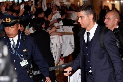 Real Madrid star Cristiano Ronaldo, right, at the Haneda International Airport, Tokyo.
