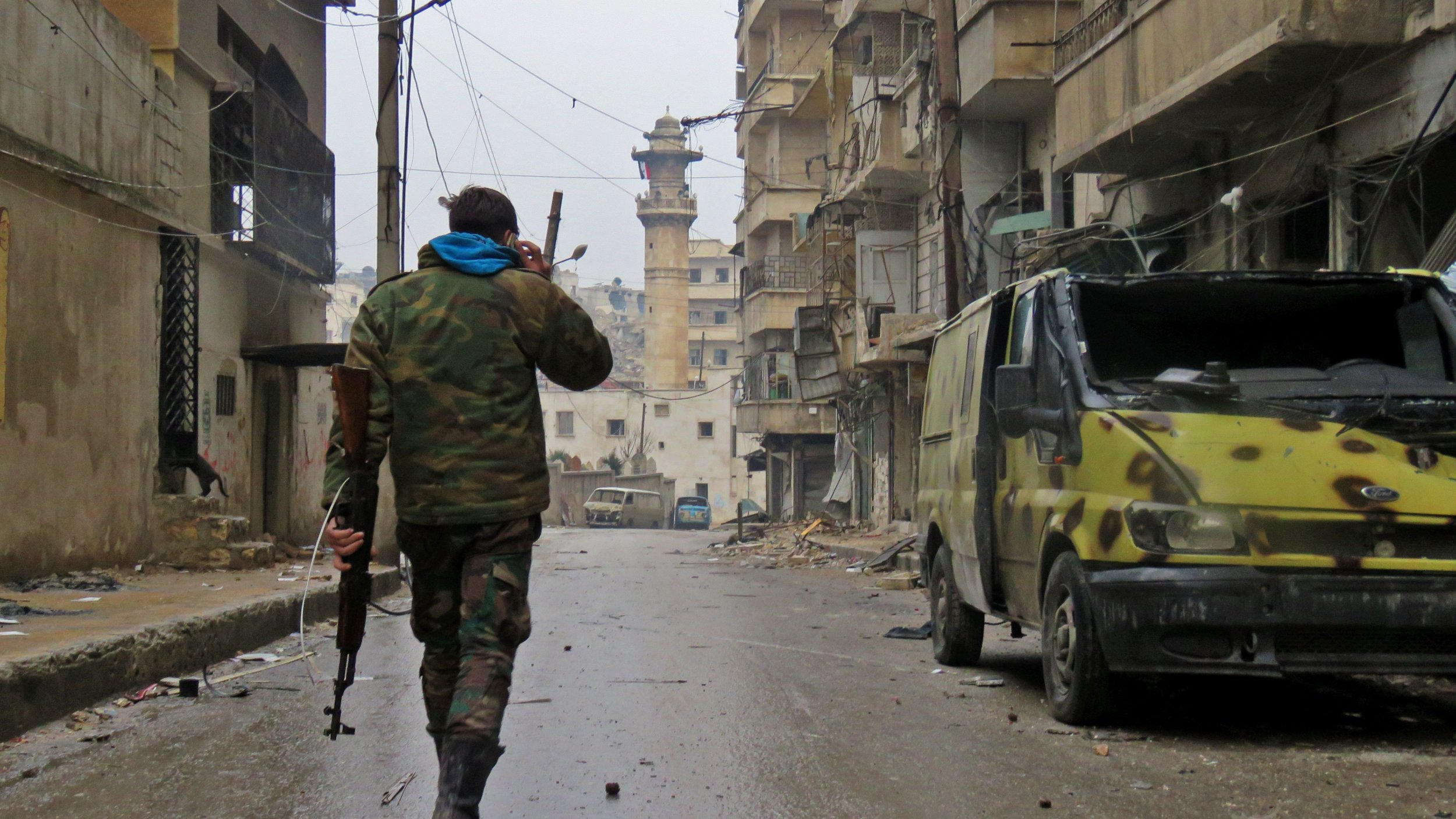 Syrian soldier walking in Aleppo